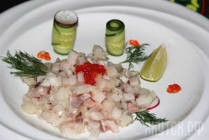 Photo Russian Salad Indigirka with raw Fish