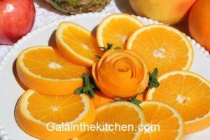 How to serve orange fancy way with flower. Photo.
