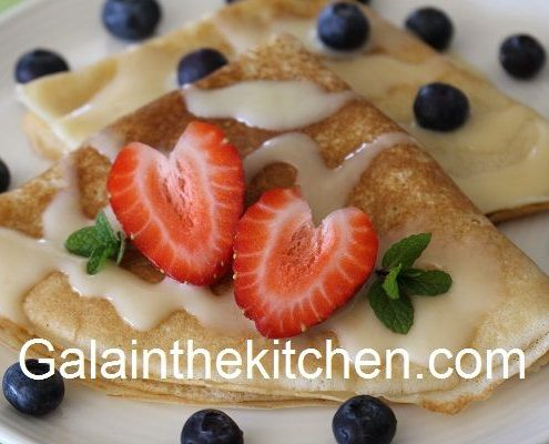 Russian blini garnish with strawberry hearts Photo