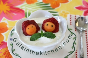 Photo Faces from strawberry with melon baller